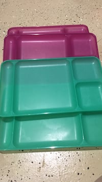 several green and pink plastic sectioned plates