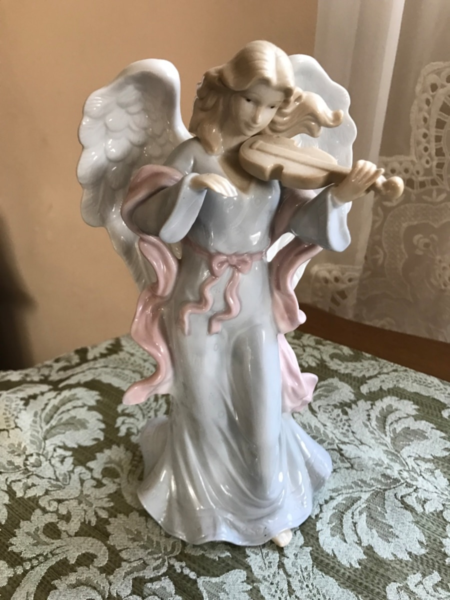 Four angel string instrument figurines - United States
