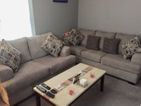 Sofa and loveseat with pillows, coffee and end tables BOSTON
