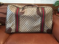 Vintage Authentic Gucci Monogram Travel Bag.