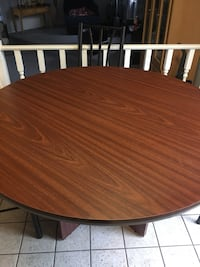 Oval brown wooden dining table and 3 chairs  30 km