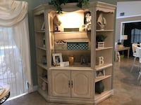 3 piece antique white wall unit. Center piece has lower storage w/glass shelves and lighting in center . Coral Springs, 33067