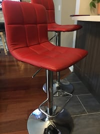 Two red padded stools Mississauga, L5N