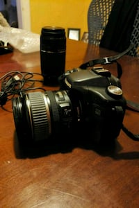 black Canon 50D EOS DSLR camera with two Canon len Toronto, M6H 2X9