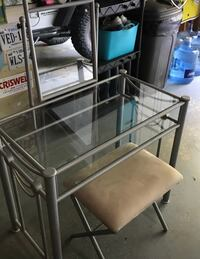 Rectangular clear glass top table with gray metal base