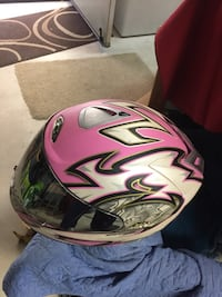 Pink, white, and black full-face helmet Homeland