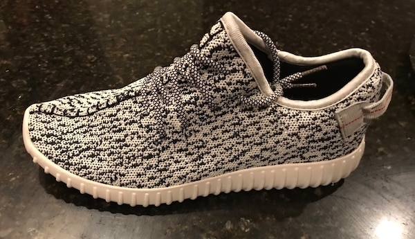 premium selection 9602a 3c340 Pair of black and white look alike adidas yeezy boost 350