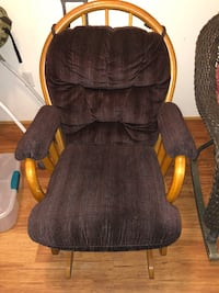 Gliding rocking chair with red cushions and a foot stool Greeley, 80634