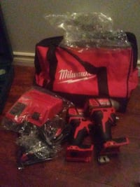 Brand New Milwaukee M18 Red Lithium ion Drill and Driver set.