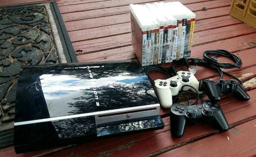 Sony PS3 w/3 controllers and 10 assorted games