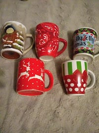 five red and white ceramic mugs