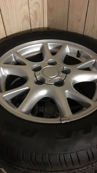 Gray 5 lug auto rims;p245/50zr16