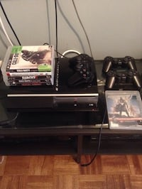 Black ps3 one console with controller and game cases Toronto, M9C