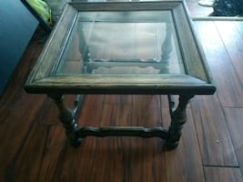 Antique glass top end table.