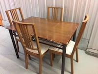 rectangular brown wooden table with four chairs dining set Montreal, H4C 2C7
