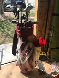 brown and white RAM golf bag with glof club Louisville, 40272