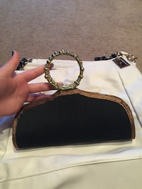 black and brown leather clutch bag