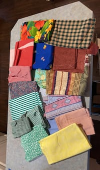 Box of assorted patterned fabric