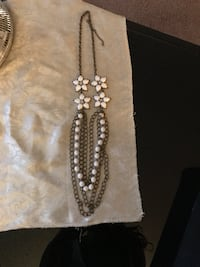 embellished white gemstone silver-colored flower cutout pendant chained necklace