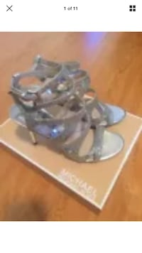 pair of women's silver Michael Kors open toe strappy pumps