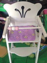 White wooden high chair with purple cushion ( price negotiable)
