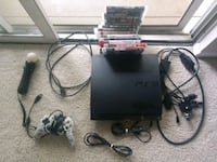 black Sony PS3 slim console with controller and game cases Columbia, 21046