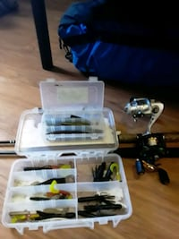 1 bait caster and two tackle boxes and 1 spinner rod