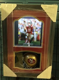 Joe Montana custom designed player shadowbox with LED lighting and autographed 49'ers mini helmet. Includes Certificate of Authenticity