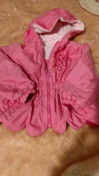 Babies coat reversible with hood.