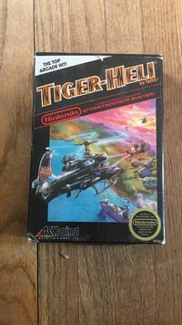 NES tiger heli game in box, box in on condition game and manual is great condition