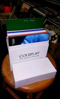 Set of Cold Play Collectible Small Vinyl Records