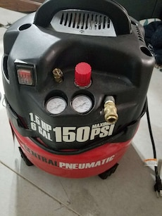 black and red Central Pneumatic 6 gal air compress
