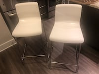 two white leather padded chairs Arlington