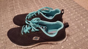 pair of black-and-teal Skechers running shoes