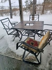 Patio furniture. With red umbrella and red cushions in good condition