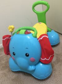 Teal, yellow and green ride-on elephant toy