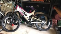 white and pink full suspension mountain bike Centreville, 20121