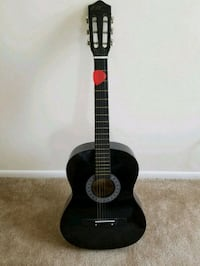 Black BC Guitar like new with pitcher tunner