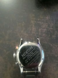 round silver-colored analog watch with black leather strap Saskatoon, S7H 0N6