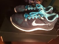 pair of black-and-blue Nike running shoes Memphis, 38128