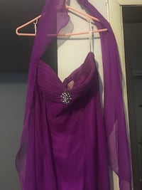 A prom dress that's only been worn one time and never again. Pretty light purple. Can wear this to a wedding or party as well. Size:14 party shoes can come with it for $50 original price:$75 also only been worn once for 30 mins shoe size:8 Crownsville