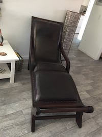 Black leather padded brown wooden armchair. Both for 180.