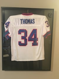 white, red, and blue Thomas 34 jersey shirt 45 km