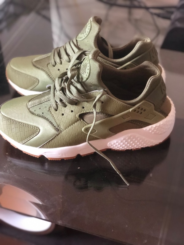 quality design a8fdc f6f9d pair of white-and-olive green Nike Huarache