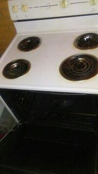 white and black 4-coil electric range oven