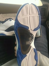 pair of white-and-blue Air Jordan shoes Oklahoma City