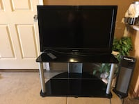 Black flat screen tv with black wooden tv stand Stockton, 95206
