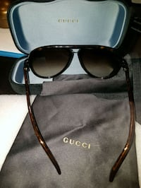 black framed Gucci sunglasses with case Mississauga