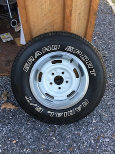 4 1967 OEM Chevy rally wheels with new tires. 14x7 with trim rings. Came off a 1967 Chevy camaro .