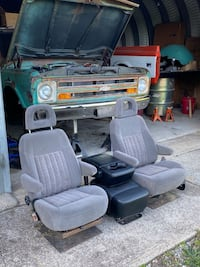 Two used bucket seats with center console